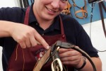 Helen Reader working on a bridle